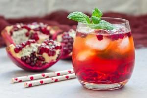 Mojito cocktail with pomegranate, mint, lemon juice and ice, horizontal